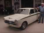 Jay Leno checks out a 1966 Lotus Cortina