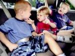 Kids buckled up in the back seat