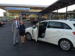 Kim Price, first buyer of 2014 Mercedes-Benz B-Class Electric Drive, and sales associate Steven Hall