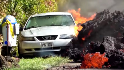 Lava flow from Hawaii's Kilauea volcano consumes a Ford Mustang