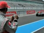 Lewis Hamilton pilots the McLaren F1 remote control car