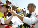 Lewis Hamilton with fans at the 2011 Goodwood Festival of Speed