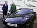 Lotus CEO Jean-Marc Gales (left) hands Clive Chapman the keys to a 2018 Lotus Evora GT410 Sport