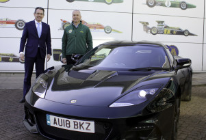 Lotus CEO Jean-Marc Gales (left) hands Clive Chapman the keys to a 2018 Lotus Evora GT410 Sport