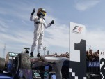 Mercedes AMG's Lewis Hamilton after winning the 2013 Formula One Hungarian Grand Prix