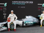 Michael Schumacher and Nico Rosberg with the 2012 Mercedes AMG Petronas W03