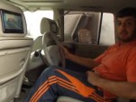 Nissan Patrol with custom backseat driving modification by King of Customs in Dubai