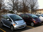 Pair of Mitsubishi i-MiEV electric cars parked at work  [photo: Jen Danzinger]