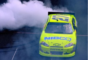 Paul Menard does a burnout in the #27 car after winning the Brickyard 400. Image via NASCAR.