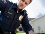 policeman reaching into car