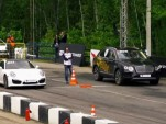 Porsche 911 Turbo and Bentley Bentayga at a drag strip