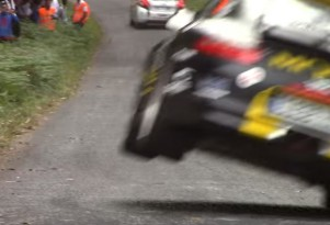 Porsche rally car almost levels spectators