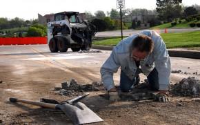 Pothole repair (via Wikimedia)
