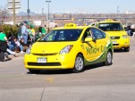 Prius Yellow Cab in Denver St. Patricks Day Parade