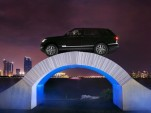 Range Rover Drives Over Paper Bridge