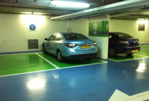 How electric-car owners in condos can get their HOAs to OK charging stations