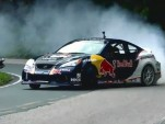 Rhys Millen drifting up a Brazilian Mountain in his Red Bull/RMR Genesis Coupe