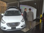 SimpleFuel team demonstrating home hydrogen fuel dispenser with Hyundai Tucson Fuel Cell