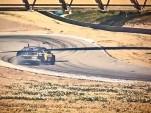 Tanner Foust drifts at Laguna Seca
