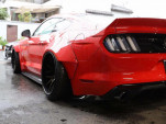 Teaser for Liberty Walk wide-body Ford Mustang debuting on October 9, 2017