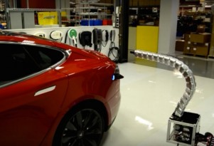Tesla Releases Video Of Snake-Like Charger Plugging Into Electric Car Automatically