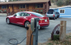 Tesla offers some employers at-work charging stations, for its cars only