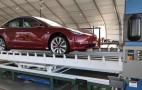 Tesla now building cars in a tent, first AWD performance Model 3 built