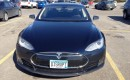 Tesla Model S with DISRUPT license plate, March 2013 [photo: Sam Villella]
