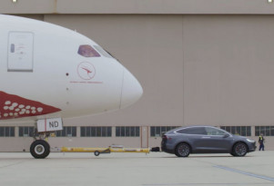 Tesla sets world record towing Boeing 787-9 Dreamliner