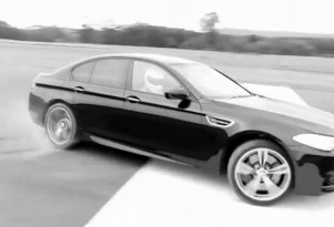 The Stig drives the 2012 BMW M5...in circles