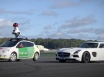 The Stig welcomes the Google Street View car to the Top Gear test track