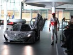 The upcoming McLaren P1 makes a cameo at the MP4-28 reveal