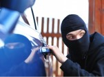 Thief Stealing a Car