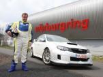 Tommi Makinen with a Subaru WRX STI