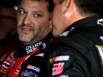 Tony Stewart confers with teammate Ryan Newman - NASCAR photo
