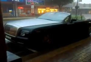 Topless Rolls-Royce Phantom Drophead Coupe in downpour