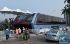Futuristic Chinese traffic-straddling bus abandoned, blocking traffic