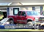 Truck Driven Through House