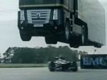 Truck jumping a Lotus Formula One car