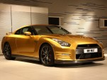 Usain Bolt and his golden Nissan GT-R