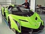 Valentino Balboni poses beside a Lamborghini Veneno Roadster painted in Verde Singh