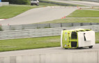 This VW Bus tipped on its side is actually a race car