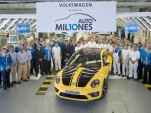 Volkswagen workers in Puebla, Mexico, celebrate the 10 millionth car built at the plant